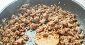 Cooked ground pork in a fry pan